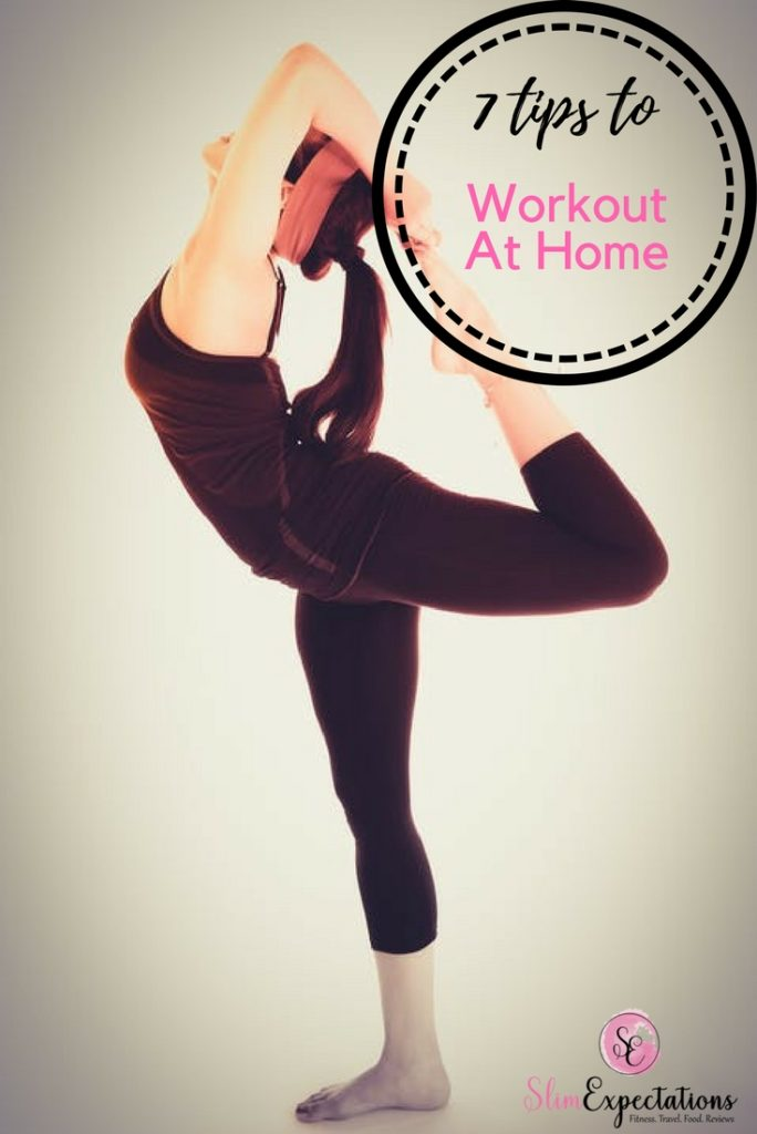 Woman stretching during workout at home
